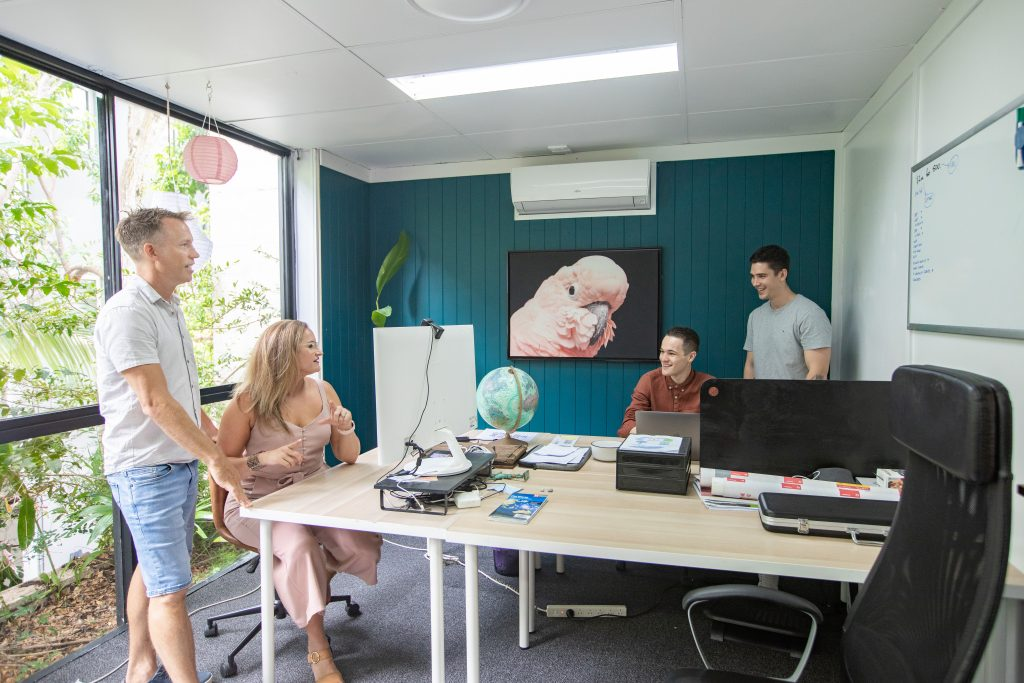 content marketing melbourne- team in office with computers and laptops