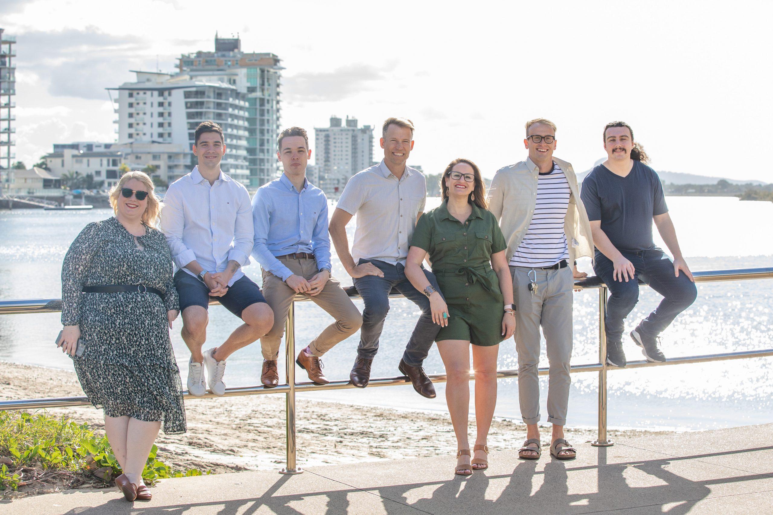 small business website - dnhq team sitting on railing