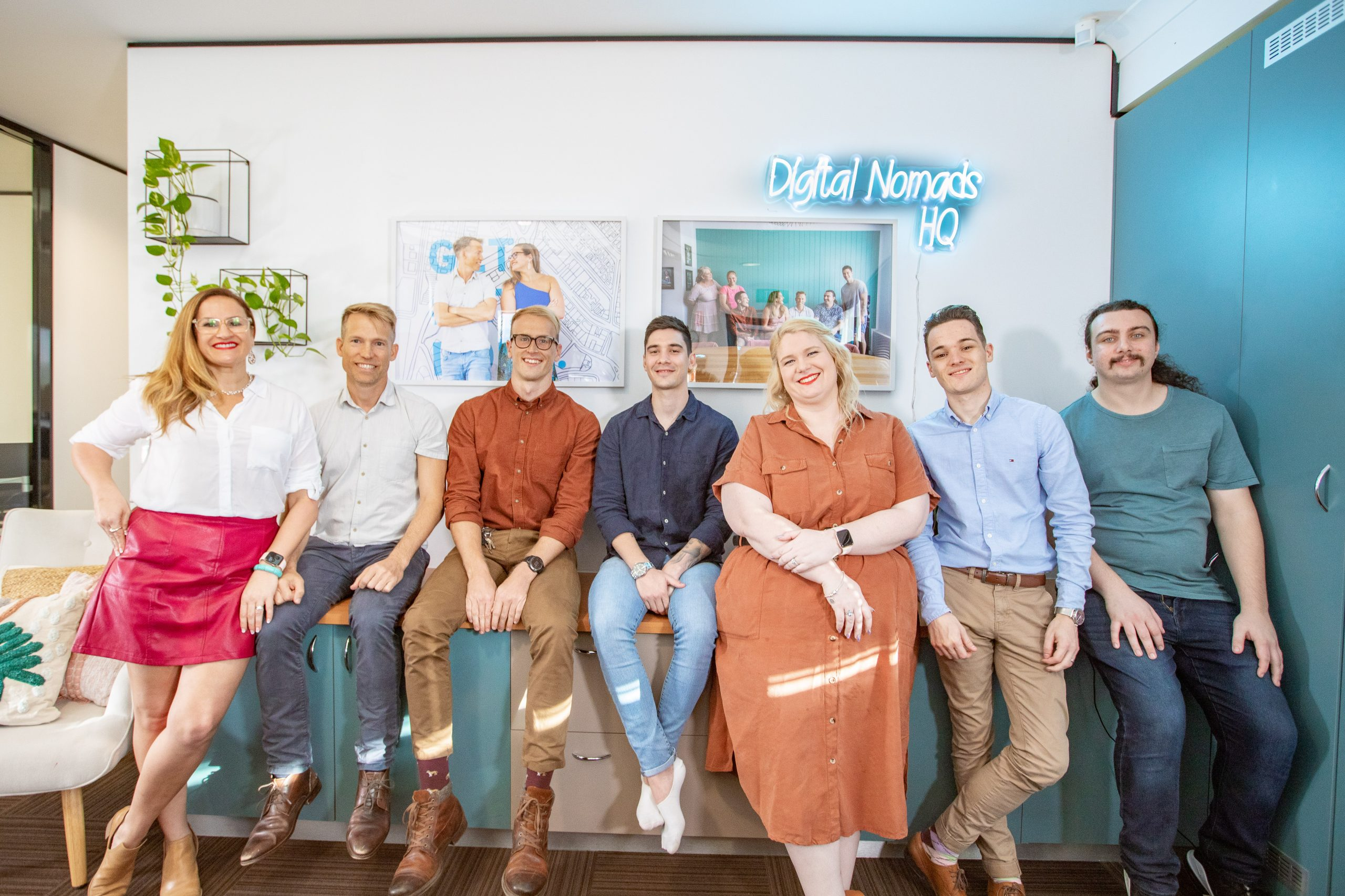 portfolio website - DNHQ team sitting on a cabinet