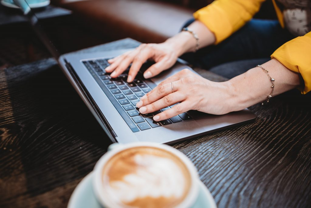 facebook ads management - person using a laptop with coffee
