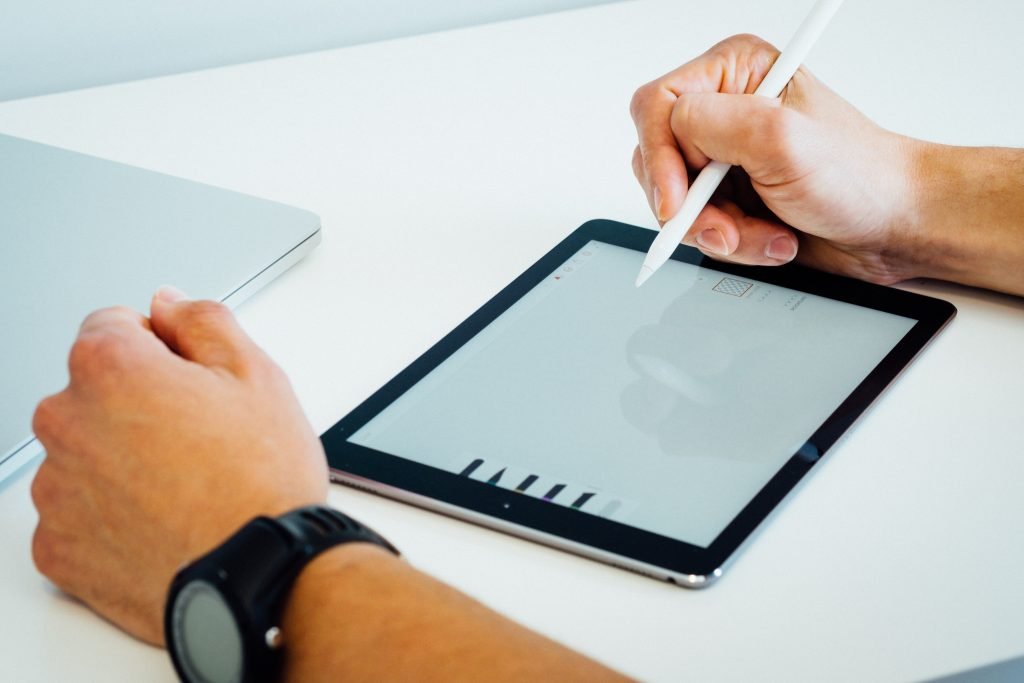 Logo Design - person using tablet to draw