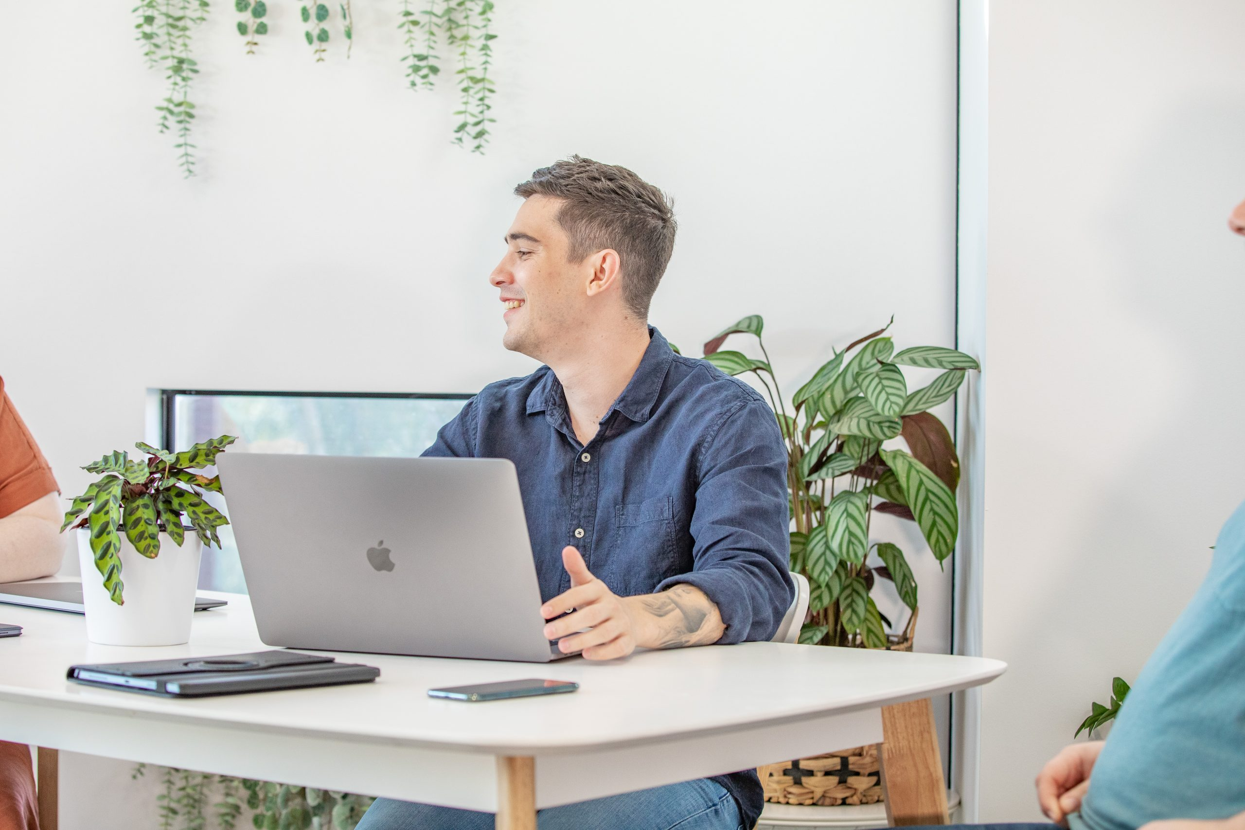 Web Design Melbourne - member of the DNHQ team using a laptop at a desk