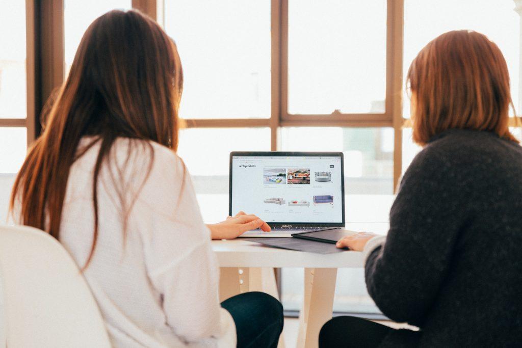 Web Design Hobart - two women using laptop